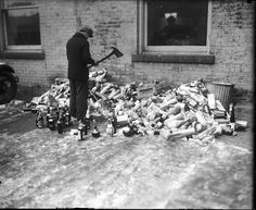 Prohibition in Detroit: A federal agent destroys confiscated liquor in 1929. (Detroit News archives)