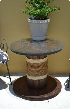 Very cool patio table made from a cable spool. I love it and you can get these cable spools free from utility companies.