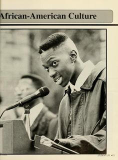 """Athena yearbook, 1993. """"Will Linson speaks to a somber crowd at the Martin Luther King, Jr. rally held at the class gate."""""""