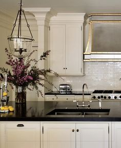 Black granite and white cabinets. by ursula..love backsplash