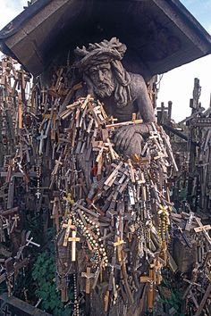 Statue of Christ and crosses left by pilgrims, Hill of Crosses