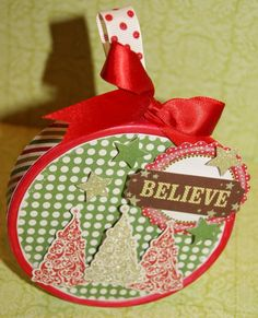 Made from a laughing cow cheese wedge box--you could put candy or something in it and hang on the tree.