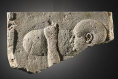 A Relief-fragment with Offering Bearer. Egypt, Late Period, 30th Dynasty, late 4th cent. B.C. Provenance : Coll. A.T., Switzerland, ca. 1950-1980.
