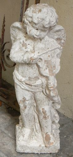 This ceramic European statue of a puckish cherub playing a violin is aged to give it a weathered appearance. Great #gift for the gardener! $195 | www.bevolo.com.
