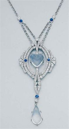 White gold, moonstone, diamond and sapphire lavaliere.