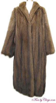 Fisher Fur Coat #F719; $2500; Excellent Condition; 10 - 14. This is a gorgeous genuine natural fisher fur coat. Fisher is a higher-end fur and is related to sable; it is a very high quality fur coat. It has a Bricker-Tunis Furs label and features a shawl collar and straight sleeves.  This fisher coat possesses an understated elegance. When you wear it, you will feel luxurious with refined sophistication!