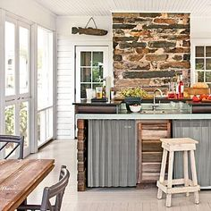 A French door connects the porch to the kitchen for easy access when entertaining. | SouthernLiving.com