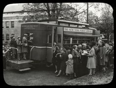 A New York Public Library book wagon at destination [Bronx?], ca. 1930s.
