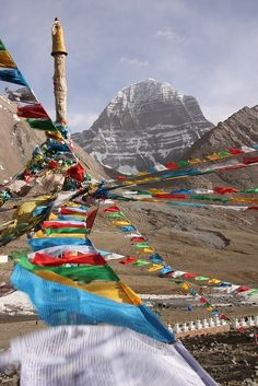 Prayer Flags leading the eye towards Mt Kailashs unbroken north face - Tibet, China