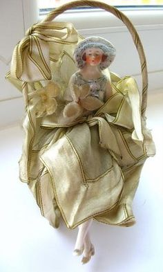 Vintage Porcelain Half Doll Pin Cushion. Photo via ebay....