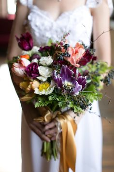 Parrot tulip, ranunculus, poppy, and spray rose bouquet | Christy Tyler Photography | see more on:  http://burnettsboards.com/2014/08/life-wedding-inspiration/
