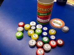 Math facts using recycled bottle caps -- genius! Download the file to print labels for all four operations.