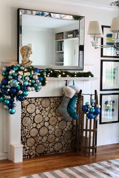 blue ornaments in a big dripping group + stacked wood