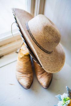 cowboy boots and hat! photo by David Pascolla http://ruffledblog.com/santa-margarita-ranch-wedding #rusticwedding #weddingaccessories