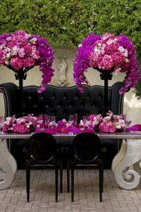Black candelabras featuring hot pink hydrangea, pink peonies, roses and purple phalaenopsis orchids presented on a silver-leaf table. Location: Pelican Hill Newport Coast, CA; Table and Floral Design: Christopher Aldama Fiori Fresco Special Events La Habra Heights, CA; Table, Banquette and Chairs: Luxe Event Rentals Los Angeles, CA; Napkins and Napkin Rings: Roberta Karsch-Resource One, Inc. Reseda, CA; China: Classic Party Rentals Santa Ana, CA; Photography: Mike Colón Photographers Newport Coast, CA