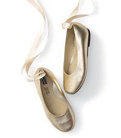 gold ribboned ballet shoes