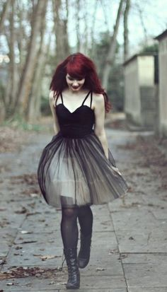 everything about this photo: model, dress, tights, boots, hair, location, lips <3