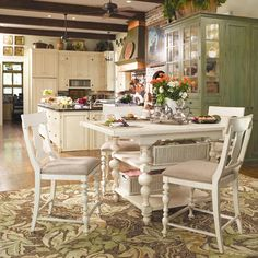 I Love everything about this kitchen! -- drool!     Paula Deen Home Counter Height Kitchen Gathering Table with Storage Baskets by Paula Deen by Universal - Baer's Furniture - Pub Table Miami, Ft. Lauderdale, Orlando, Sarasota, Naples, Ft. Myers, Florida