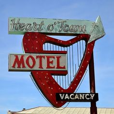 This would be the type of place to have a heart shaped jacuzzi.--STRANDED KOSMONAUT: Vintage Motel Signs
