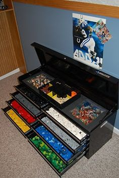 Lego Storage ~ use a tool box!  Glue the flat Lego sheets to the top!  LOVE THIS IDEA!