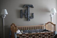 Aged metal letters? Sure looks like it - faux painting on cardboard! Easy to hang and awesome looking!