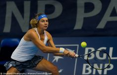 Stefanie Voegele during the first round of the Luxembourg Open 2014 http://www.womenstennisblog.com/2014/10/14/cornet-lisicki-advance-luxembourg-highlights/