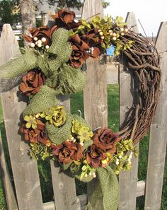 This is with some green #burlap #wreath and brown roses, small green flowers and berries...alot of fun making this one  www.facebook.com/wreathswithareason