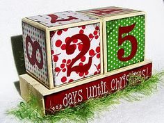 """Countdown to Christmas blocks using favorite Christmas scrapbook papers!  The blocks are 4x4 each and the base is around 9"""" long. You can customize the look changing the paper to any color you like."""