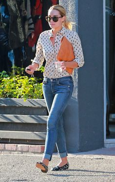Lauren Conrad in jeans, a printed button-down, and flats