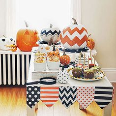 Halloween table + printed flags + painted pumpkins