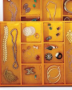 Detangle Jewelry  Four divided trays, painted orange, become a layered jewelry organizer. Two trays lie flat along the drawer bottom. The remaining two, joined with wood glue, form the top shelf, elevated by strips of 1-inch square molding affixed to the inner sides of the drawer.