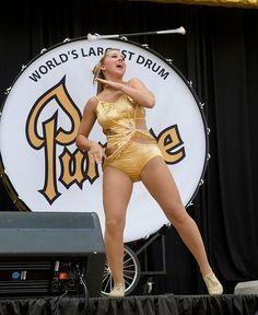 Merribeth Cox in front of the Purdue drum.