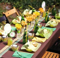 Ribbons - such a great/cheap idea for a runner!  Also - this is an adorable set up for a babyshower - 'diaper'-folded napkins, baby bottle vases, and a picnic lunch.
