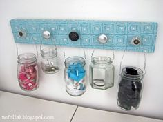 At Nefotlak there's a tutorial for a hair station/organizer made of jars and knobs.