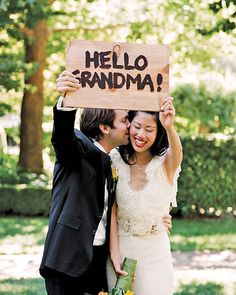 Send a shout-out to two family members that couldn't make it to your big day with a cute crafted sign  This shows them you really thought of them and surely would be touching :)