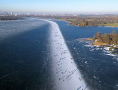 Absolutely incredible  Ice skating on Paterswoldse Meer, a lake just South of the city of Groningen in the Netherlands.