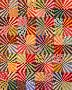 Ferris Wheel Fan Quilt and Pattern (for purchase) - note the effect of using striped fabric in the fans | Karen Griska Quilts