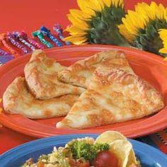 Mozzarella Wedges Recipe: crescent rolls, 1Tbls butter, garlic powder, mozzarella cheese.