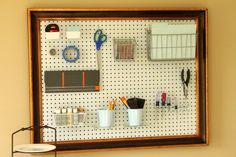 Framed peg board for sewing supplies---could use a thrifted old painting and fill with peg board. LOVE IT!