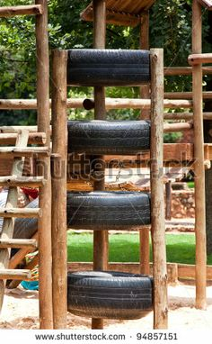 """jungle gym, made of somewhat used tires. I had a really sweet one back in grade school, it was """"HUGE"""" with slides and tunnels, I definitely intend on re-creating one like it for my backyard"""