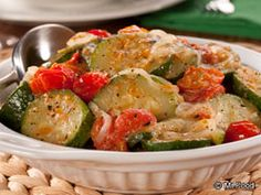 Italian-Style Zucchini with Tomatoes - This easy summer side dish recipe is sure to be a hit at dinnertime!