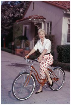 American actor Doris Day poses on a red Schwinn bicycle, late 1950s. (Photo by Hulton Archive:Getty Images 1955)