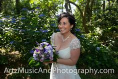 "Bride peeking out from behind a flowering bush, just before she has a ""First Look"" at her groom."