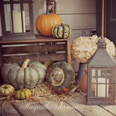 Fall Decor for the Front Porch! Love the different shades of gourds!