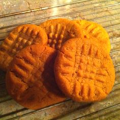 The easiest and best peanut butter cookies I've ever made. 1 cup peanut butter, 1/2 cup white sugar, 1/2 cup brown sugar, 1 egg. (You can use 1 cup white sugar, but I wanted the mix.) Mix well and place in fridge for 15 minutes so they are easier to work with. Grease a cookie sheet with Pam. (I used a stone cookie pan...works FABULOUSLY.) Roll into a half dollar sized ball and make criss cross pattern with a fork. 350 for 15 minutes and viola!!! It can't get easier than this.
