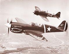 P40 Warhawk and a Mitsubishi Zero (WWII planes)
