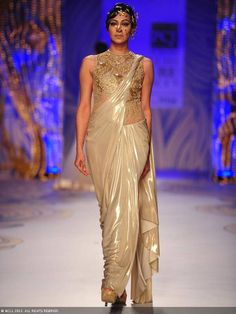 Tina Chhatwal showcases a creation by designer Gaurav Gupta on Day 5 of Delhi Couture Week, held in New Delhi, on August 04, 2013.