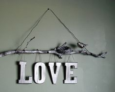 I would like this without the nest and bird and a different word... Last name?