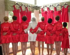 I love this picture idea of the bridesmaids & the bride-- with the dresses in the background!