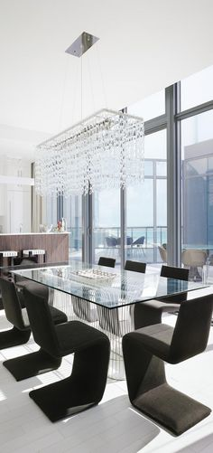 Chic dining room with ocean view..luv the rectangular chandelier..